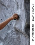 Small photo of A close-up of the hand of a child climbing a mobile climbing wall