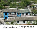 A typical apartment houses in outskirt slum of Wonsan. All housing for householders is provided by the state for free