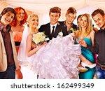 groom  carries bride on his... | Shutterstock . vector #162499349
