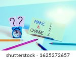 Small photo of Text sign showing Make A Change. Conceptual photo Create a Difference Alteration Have an Effect Metamorphose Mini size alarm clock beside stationary placed tilted on pastel backdrop.