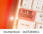 Small photo of Conceptual hand writing showing We Re Hiring. Business photo showcasing recently employ someone or pay him to do particular job.