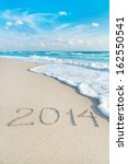 Inscription 2014 On Sea Sand...