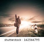guitarist on a road to horizon | Shutterstock . vector #162566795