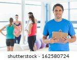 portrait of an instructor with... | Shutterstock . vector #162580724