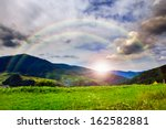 valley near forest on a steep mountain slope after the rain in morning mood - stock photo