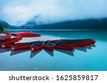 Beautiful Red Canoes Docked At...