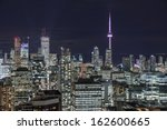 Stock photo full view of downtown toronto at night with glamour lights 162600665
