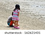 two kids playing on the sand... | Shutterstock . vector #162621431