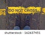 male sneakers on the asphalt... | Shutterstock . vector #162637451