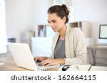 Attractive Woman Working In...
