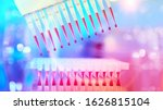 Small photo of Scientific neon lights, futuristic background. Multichannel pipette tips filled in with reaction mixture to amplify DNA in plastic wells. next generation sequencing high throughput.