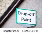 Small photo of Drop off point sign for charity shop donation and recycle yard for goods toys food bank and clothes for welfare and the poor