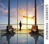 businessman at airport looking... | Shutterstock . vector #162683375
