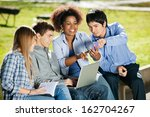happy young students with using ... | Shutterstock . vector #162704267
