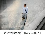 Happy Young Businessman Walking ...