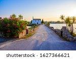 Ypapanti Church - Beautiful scenery at sunset in Gouvia Bay – small ancient white church on a pier, Corfu island, Ionian sea, Greece, Europe