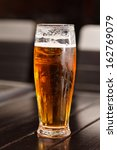 glass of fresh lager beer | Shutterstock . vector #162769079