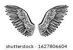 pair of spread out wings ...   Shutterstock .eps vector #1627806604