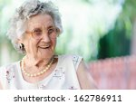 Stock photo portrait of a smiling elderly woman 162786911