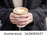 Woman Hands Holding Hot Coffee...