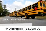 School Buses Lined Up At Schoo...