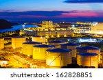 oil tanks plant during sunset | Shutterstock . vector #162828851