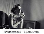Shocked Woman Talking On Phone...
