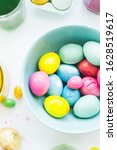 coloring hard boiled eggs... | Shutterstock . vector #1628519617
