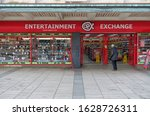 Small photo of Plymouth England January 2020. Entertainment Exchange. National chain of high street retailers of video games, mobile phones and cameras, buy outright or part exchange. Double shop frontage, signage.