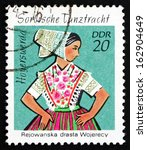 Small photo of GDR - CIRCA 1971: a stamp printed in GDR shows Sorbian Dance Costume, Hoyerswerda, circa 1971
