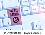 Small photo of Writing note showing Project Planning. Business photo showcasing plan and subsequently report progress within the project.
