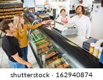 couple purchasing meat from... | Shutterstock . vector #162940874