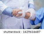 Small photo of Doctor holding touching hands Asian senior or elderly old lady woman patient with love, care, helping, encourage and empathy at nursing hospital ward : healthy strong medical concept