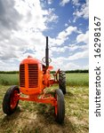 An Old Orange Retro Tractor In...