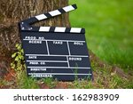 clapperboard standing at tree... | Shutterstock . vector #162983909
