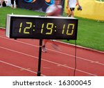 Finishing runner during a triathlon with stopwatch - stock photo