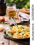 pan fried italian pasta with... | Shutterstock . vector #163004834