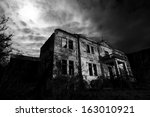 Derelict Abandoned Horror House at Night - stock photo