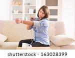 beautiful woman checking her... | Shutterstock . vector #163028399