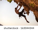 Rock Climber Against Sky At...