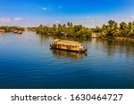 House boat wading through Alappuzha Backwaters. in Kerala India