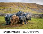 Winter Hay Bails On A Trailer...