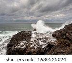 Wave Crashes On Stone Coast...