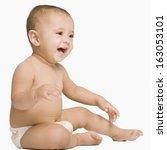baby boy smiling | Shutterstock . vector #163053101