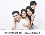 portrait of a happy family on... | Shutterstock . vector #163058615