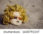 Creepy Head Of The Doll In Sand ...