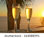 Champagne Glasses At Sunset