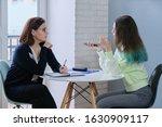 Woman Social Worker Talking To...