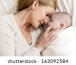 blond young mother with her... | Shutterstock . vector #163092584