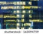 modern office building at night   Shutterstock . vector #163094759